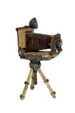 Historical camera. Model of old photographic camera on white background Stock Images