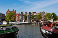 Historical canalhouses on the Amstel canal in Amsterdam. Historical canalhouses on the Amstel canal in the old center of Amsterdam, the Netherlands royalty free stock images