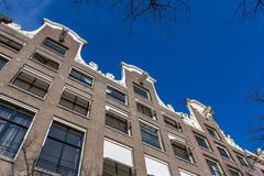 Historical canalhouses on the Keizersgracht. Historical Dutch canalhouses in a blue sky on the Keizersgracht in Amsterdam stock photography