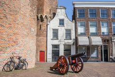 Historical cannon in front of a white house in Zwolle Stock Image