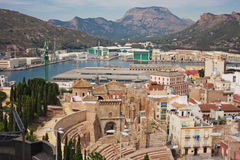 The historical center of Cartagena. Spain. View of the docks and port. Mountains on the horizon. In the foreground the ancient Roman theater Royalty Free Stock Photo