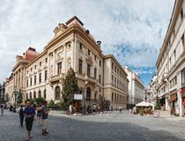 Historical center Lipscani in Bucharest, Romania. Bucharest, Romania - September 9, 2017: Panoramic view of walking tourists on the street of the historical royalty free stock image
