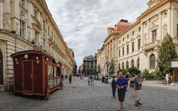Historical center Lipscani in Bucharest, Romania. Bucharest, Romania - September 9, 2017: Panoramic view of walking tourists on the street of the historical stock image