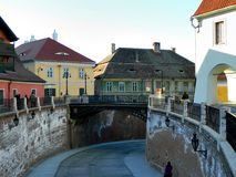 Historical Center  of Sibiu. SIBIU, ROMANIA -  FEBRUAR 4, 2014. The Bridge Of Lies , the oldest cast iron bridge , that connects the Small Square with Huet Royalty Free Stock Images