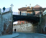 Historical Center  of Sibiu. SIBIU, ROMANIA -  FEBRUAR 4, 2014. The Bridge Of Lies , the oldest cast iron bridge , that connects the Small Square with Huet Stock Photography