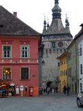 Historical center of Sighisoara, Romania. Clock Town - a hallmark of Sighisoara and some colored ancient houses Stock Photography