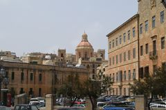 HIstorical center of Valletta, Malta. Buildings in historical center of Valetta, capital city of Malta. In background one of many churches in the city above stock image