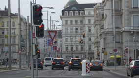 Historical center of Vienna with red signals and stoplights. VIENNA, AUSTRIA - AUGUST 2016: Many traffic lights with red signal and staying on crossroad cars stock footage