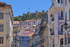 Historical centre of Lisbon city, Portugal. The visible profile of the Castle of Sao Jorge & x28;Castelo de Sao Jorge& x29; overlooking the historical centre of Stock Images