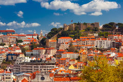 Historical centre of Lisbon on sunny day, Portugal. Aerial view of Castle of Saint George or Sao Jorge and the historical centre of Lisbon on the sunny afternoon Stock Photos