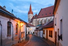 Historical centre with night illumination. Town of Znojmo, Czech Republic. Old charming paved street with night illumination in the historical centre leading to Royalty Free Stock Photo