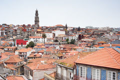 Historical centre of Porto. Panoramic view of the historical centre of Porto with the Clerigos Tower, the colorful houses cascading down the hill and, at the Royalty Free Stock Photos