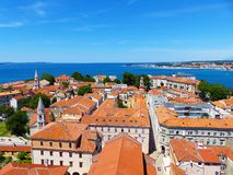 Historical centre in Zadar. View from St. Donatus church tower over the roofs and sea Stock Photography