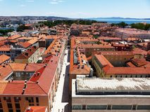 Historical centre in Zadar. View from St. Donatus church tower over the roofs and sea Royalty Free Stock Images