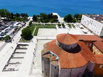 Historical centre in Zadar. View from St. Donatus church tower over the roofs and sea Royalty Free Stock Photography