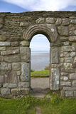Historical Chapel Ruins. Saxon ruins of St Patrick's Chapel next to stone graves in Heysham Stock Photos