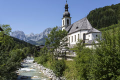 Historical church next to a mountain river Stock Photos