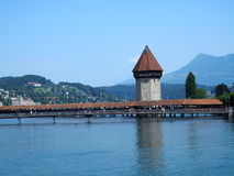 Historical city center of LUCERNE in SWITZERLAND. With famous Chapel Bridge and swiss landscape of alpine lake Vierwaldstattersee with clear blue sky in 2016 Stock Photography
