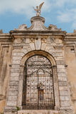 Historical city church gate with cloudy sky Stock Image