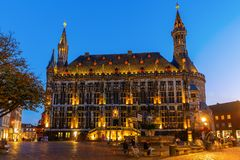 Historical city hall at night in Aachen, Germany stock images