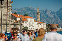 HISTORICAL CITY OF PERAST, MONTENEGRO: Tourists walk in the hist Stock Photos