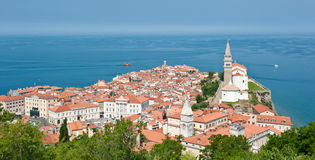 Historical city of Piran. Town at the sea. Boats. Significant church. Stock Photo