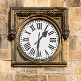 Historical clock. In a stone wall Royalty Free Stock Photography