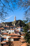 Historical clock tower in Goynuk with traditional Ottoman style houses Royalty Free Stock Photos