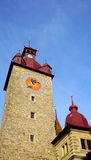 Historical clock tower in old town city Lucerne Stock Photography