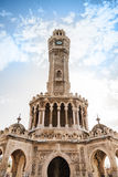 Historical clock tower under cloudy sky, Izmir. Historical clock tower under cloudy sky, it was built in 1901 and accepted as the official symbol of Izmir City Royalty Free Stock Photo