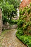 Historical cobble stone laid narrow street in Meissen, Germany stock images