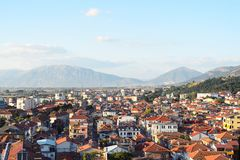 Historical and cultural city in south of Albania, Korca. Panoramic aerial view to Korca, the town in southwest of Albania, the mountains and the red tile roofs Stock Photo