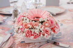 Historical delicate many shades of pink flower. Arrangement on table royalty free stock photography