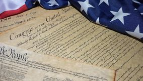 4k United States Bill of Rights Preamble to the Constitution and American Flag. Historical Document US Constitution - We The People with American Flag stock video