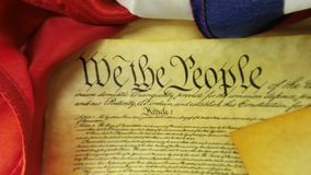 Historical Document US Constitution - We The People with American Flag. Preamble to the Constitution of the United States and American Flag