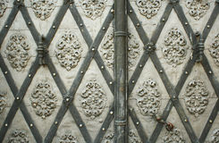 Historical door. Detail of an old substantial church door royalty free stock images
