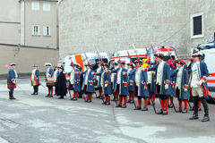 Historical dressed men against ambulance cars Royalty Free Stock Image