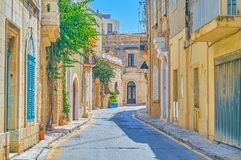 The historical edifices in Mosta, Malta. The best way to explore the town is to walk along its narrow streets and lanes, enjoying magnificent architecture old royalty free stock photography