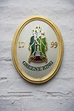 A historical emblem of Greene King brewery. Close up of the wall decor. Cambridge, UK Stock Image