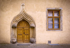 Historical Facade. Detail of an old, historical Facade with typical stone seats from the 16th century in the medieval town Wittenberg, Germany, late gothic style stock photography