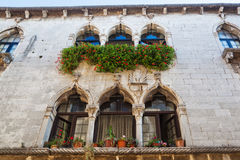 Historical facade in Porec, Croatia. Facade of a historical building in Venetian style in Porec, Croatia royalty free stock photos