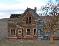 Historical Fairfield houses and Tree. This historic house was out in some plowed farmlands. along a back road in the outback of northern Oregon it was a great Royalty Free Stock Photography