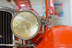 Historical fire truck front lamp. Veteran fire truck front lamp detail in a museum Royalty Free Stock Photography