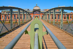 Historical fish market in Hamburg, Germany. Historical footbridge leading towards fish market in Hamburg, Germany, on a bright day Royalty Free Stock Photography