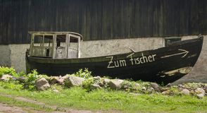 Historical fishing boat ashore on the island usedom royalty free stock photos