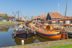 Free Historical Fishing Vessels Anchored In Harbor Dutch Fishing Village Workum Royalty Free Stock Photography - 115442097