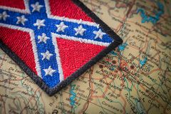 Historical flag of the south of the United States on the background of the USA map. View of the Historical flag of the south of the United States on the stock image