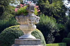 Historical flowerpot with human head statue in castle garden. Photo royalty free stock images
