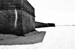 Historical fort on beach in black and white Stock Photo