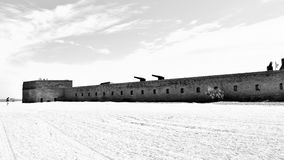 Historical fort on beach in black and white Stock Photos